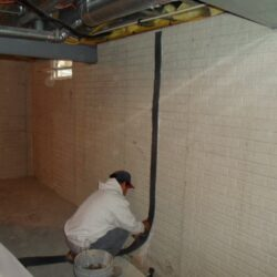Basement Wall Crack Repair Kit Being Installed | SouthernDry of Alabama